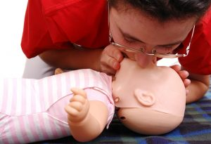 Giving rescue breaths to the infant