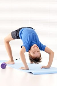 child doing bridge pose