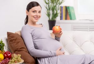 Pregnant woman having nutritious food