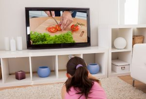 Kid learning cooking by TV