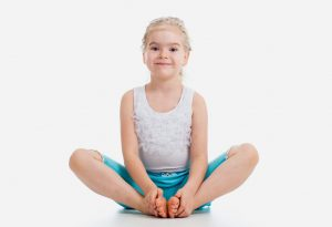 child doing butterfly pose