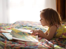 child reading storybook