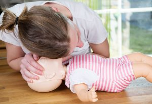 checking for signs of breathing in infant
