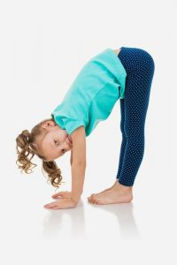 child doing rag doll pose