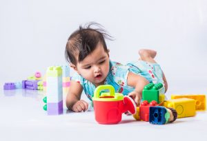 Baby playing with colourful toys