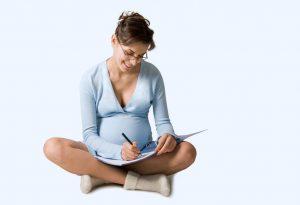 Pregnant woman writing birth plan