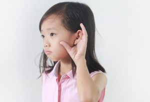 Child with hearing defect