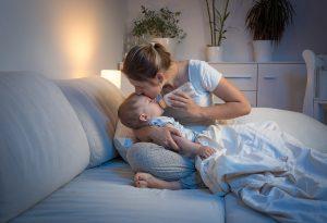 Baby taking formula milk at night
