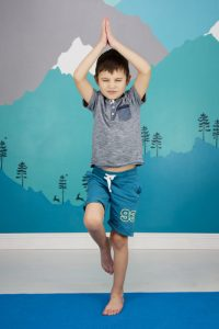 child doing mountain pose