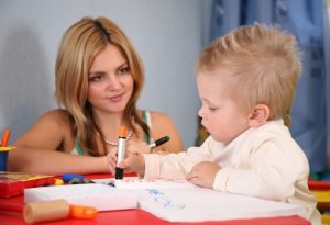 mother painting with son