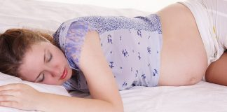 Pregnant woman sleeping on stomach