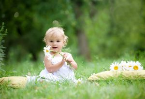 Baby exploring flowers