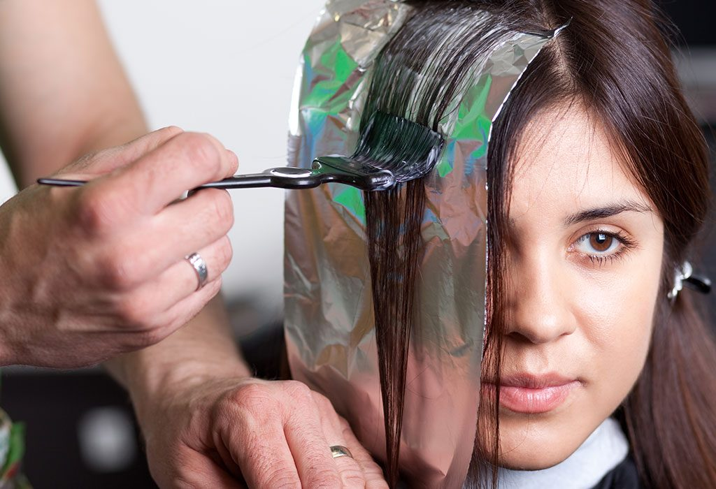 Woman getting hair coloured