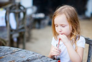 girl drinking a soft drink
