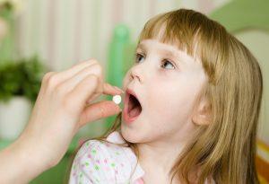 Daughter taking medicine
