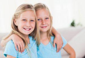 Twin girls in blue t-shirts