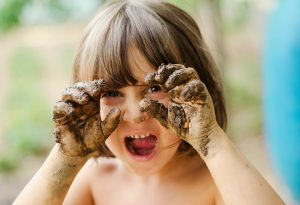 Kid with soil while playing