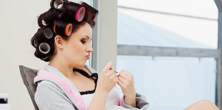 Pregnant woman doing manicure
