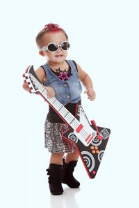 A boy dressed as a rockstar