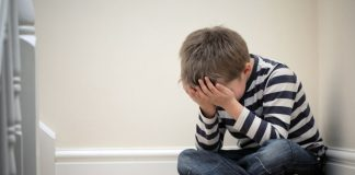 A little boy feeling lonely and depressed