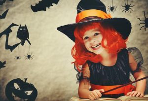 A girl dressed as a witch