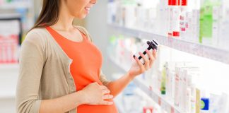 A pregnant woman buying medicines at a pharmacy