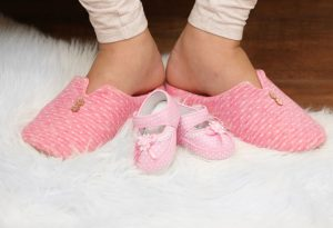 Pregnant Woman's Feet on Soft Surface