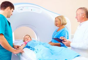 A child being taken for a scan