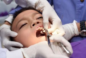 dental extraction of a boy