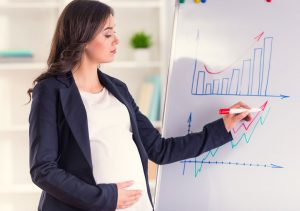 Pregnant woman standing position in office