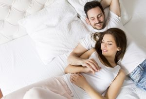 Young wife and husband in bed