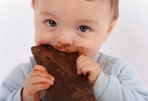 Baby eating chocolate
