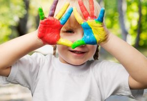 Child playing with colours