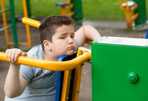 Obese tired child in park