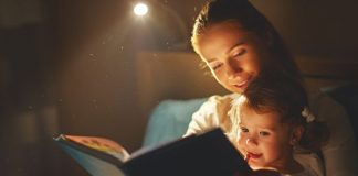 Mother reading to her kid
