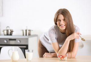 Woman eating at home