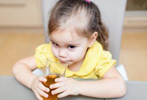 Kid drinking apple juice