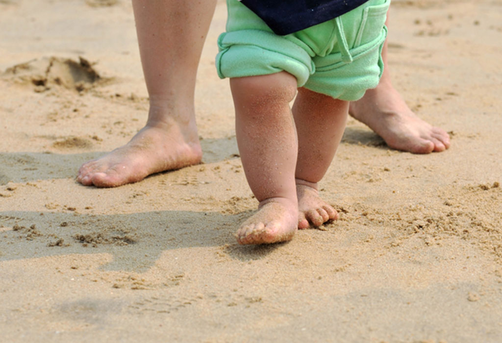 Baby walking on the beach