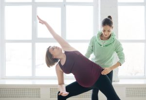 Pregnant woman with instructor