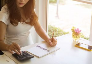 Pregnant woman with pregnancy calculator