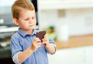 child enjoying a chocolate