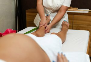 Pregnant woman getting foot massage