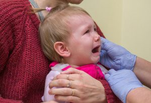 Baby crying during ear piercing