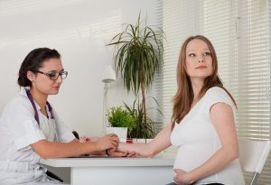 Pregnant women consulting with Gynaecologist