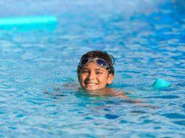 A boy swimming in pool