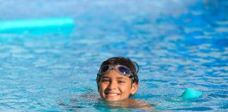 A boy swimming in pool