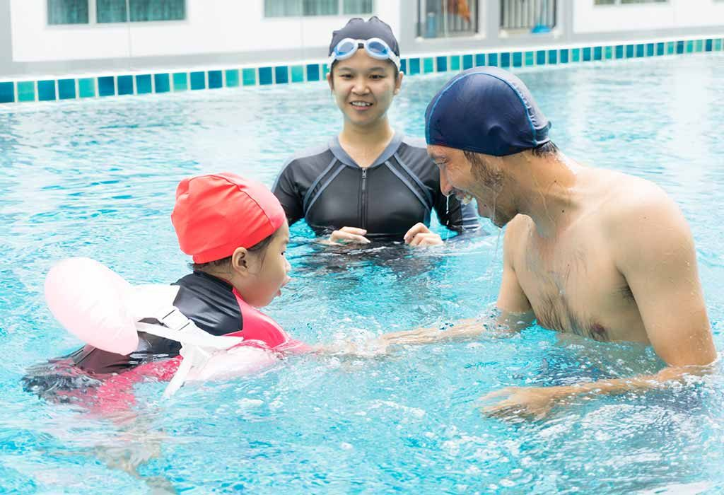 Parents with a child in a swimming pool