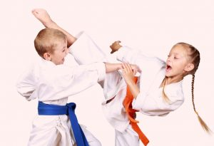 Kids practising the art of protecting from an attack
