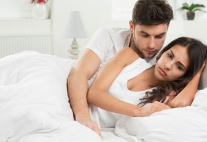 Tensed couple in bed
