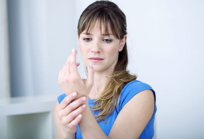 A woman suffering from wrist pain